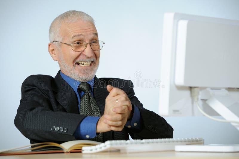Homem de negócios sênior afortunado fotografia de stock royalty free