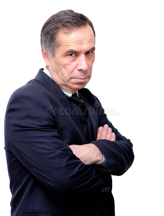 Homem de negócios sênior sério que olha os braços dobrados imagens de stock royalty free