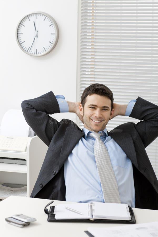 Homem de negócios satisfeito imagem de stock royalty free