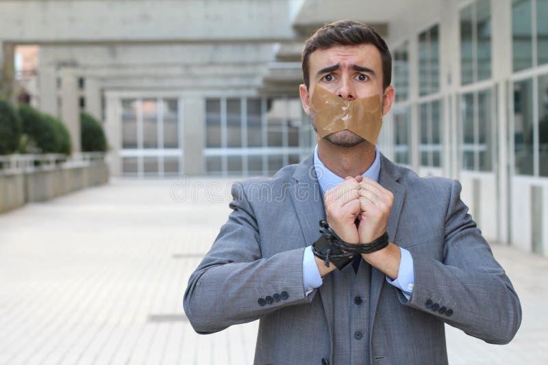 Homem de negócios sequestrado com espaço da cópia foto de stock royalty free