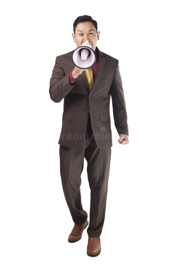Homem de negócios Shout com megafone fotos de stock royalty free