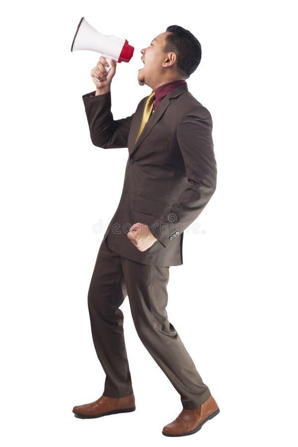 Homem de negócios Shout com megafone foto de stock
