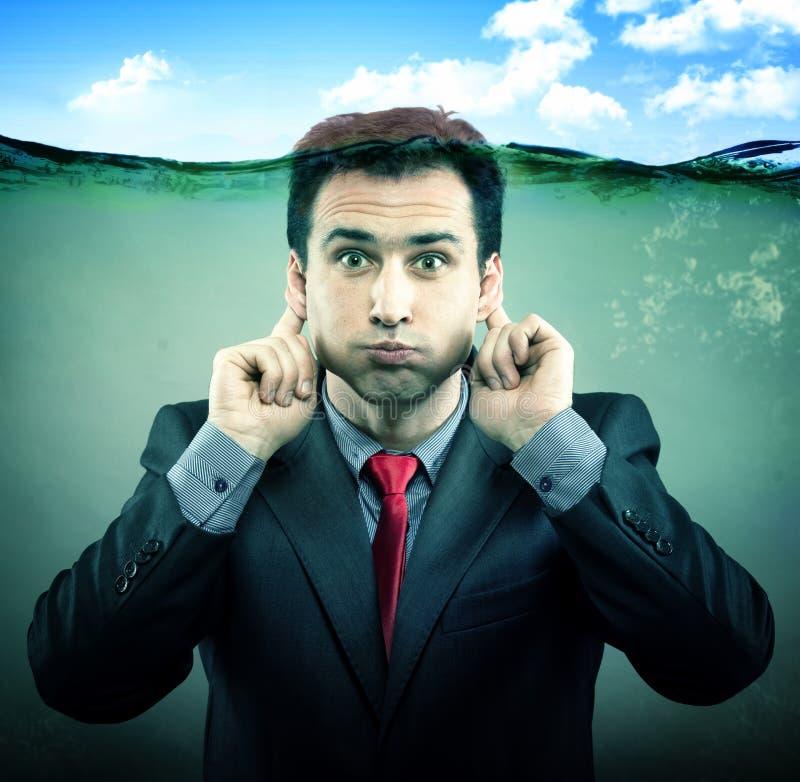 Homem de negócios sob a água fotografia de stock royalty free