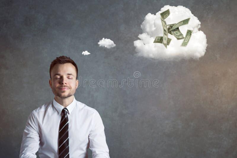 Homem de negócios de sorriso que pensa do dinheiro fotos de stock royalty free
