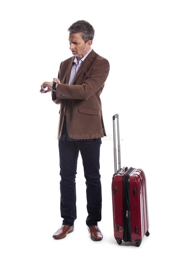 Homem de negócios Stressed no voo atrasado ou cancelado para a viagem de negócios fotografia de stock royalty free