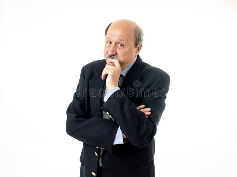 Homem de negócios superior pensativo concentrado sério seguro do retrato que pensa e que planeia fotografia de stock royalty free