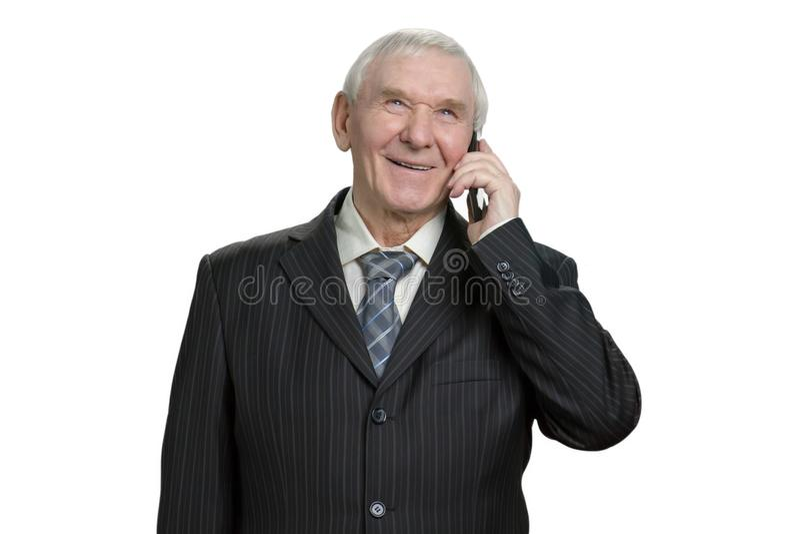 Homem de negócios superior que fala no telefone fotografia de stock royalty free