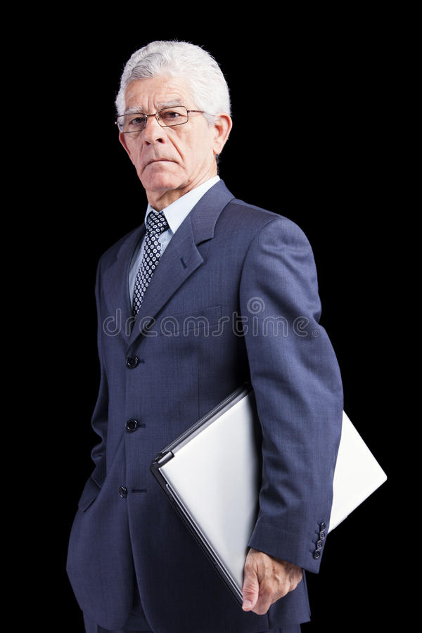 Homem de negócios superior que guardara um portátil fotos de stock