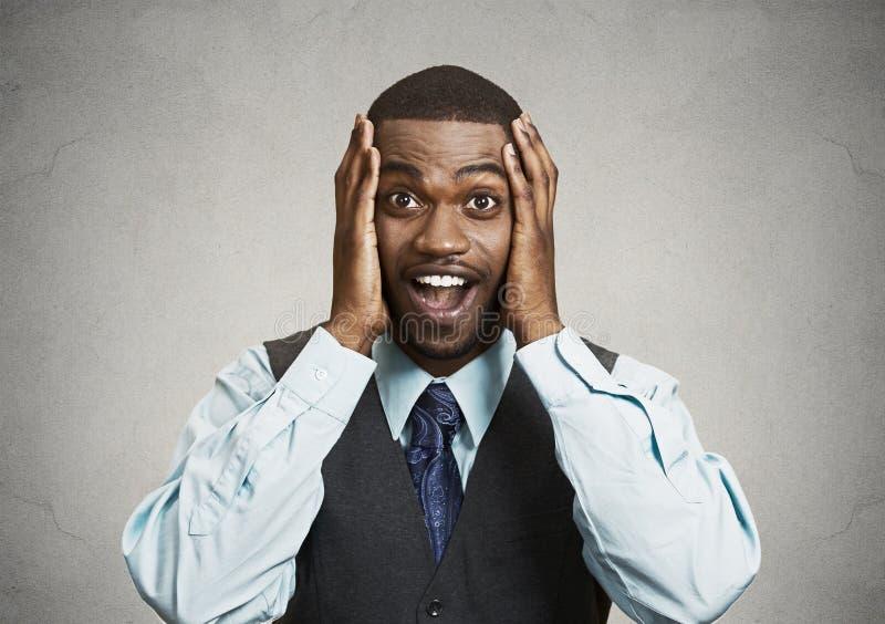 Homem de negócios surpreendido, feliz fotografia de stock