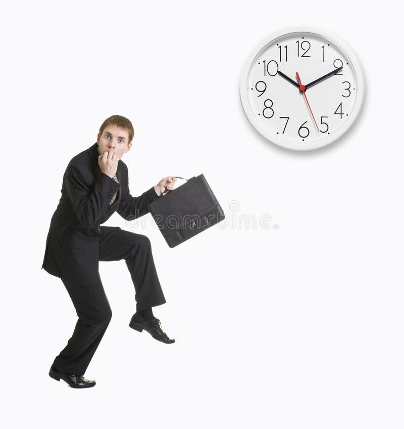 Homem de negócios tarde a trabalhar fotografia de stock