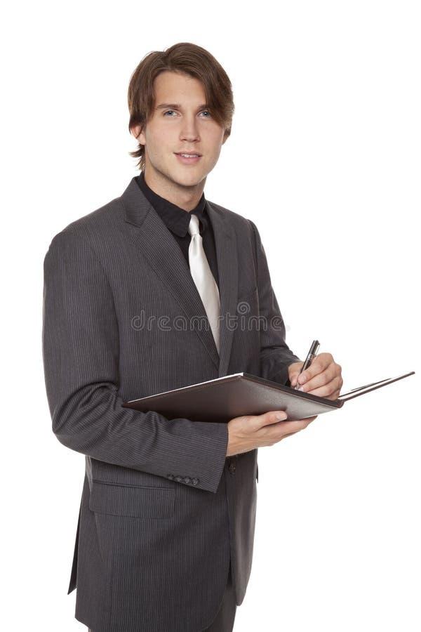 Homem de negócios - tomando notas foto de stock