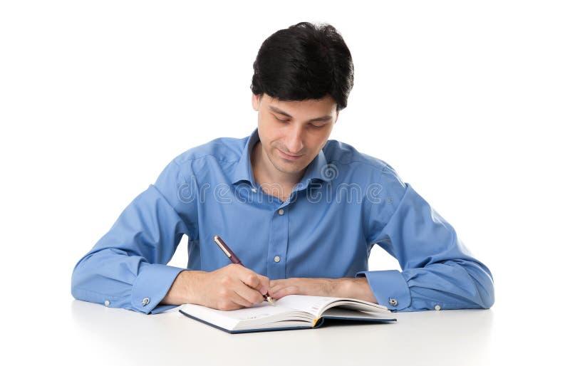 Homem de negócios Working On Paperwork foto de stock
