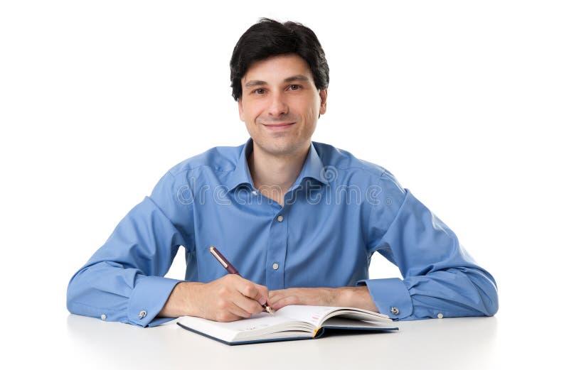 Homem de negócios Working On Paperwork imagens de stock
