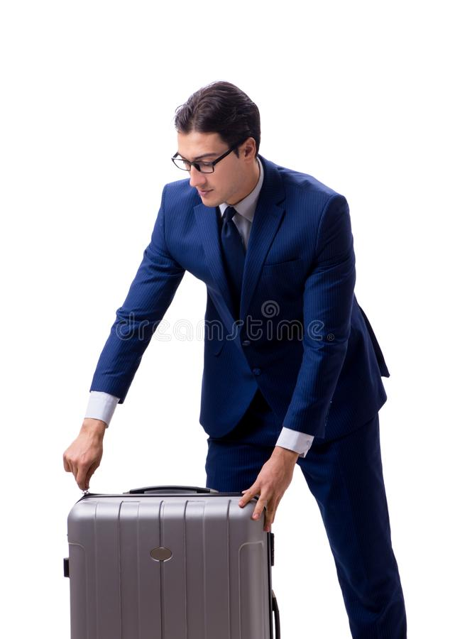 Homem de neg?cios novo com a mala de viagem isolada no fundo branco foto de stock royalty free