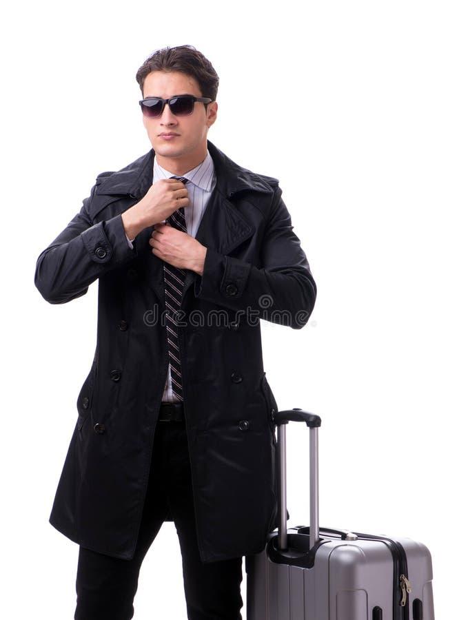 Homem de neg?cios novo com a mala de viagem pronta para a viagem de neg?cios no branco foto de stock