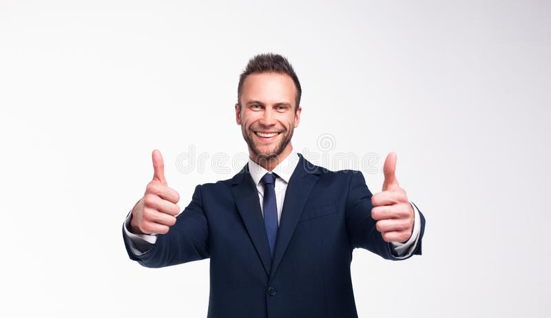 Homem de neg?cios de sorriso sobre um fundo branco fotografia de stock royalty free