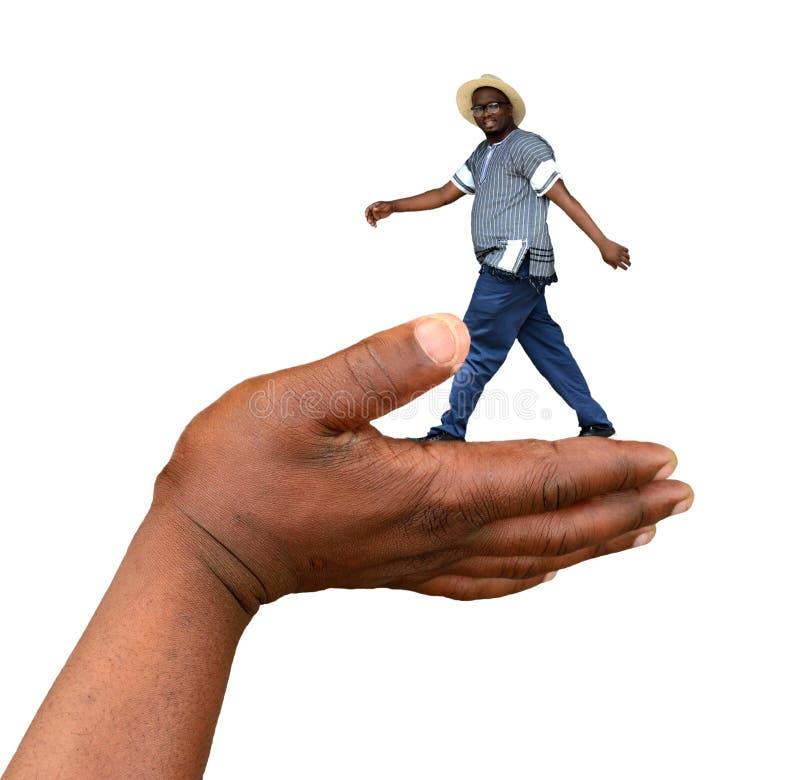 Homem de passeio levado por uma mão grande fotografia de stock