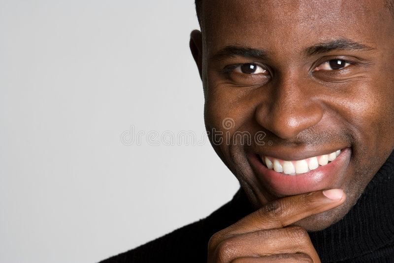 Homem de pensamento de sorriso foto de stock royalty free