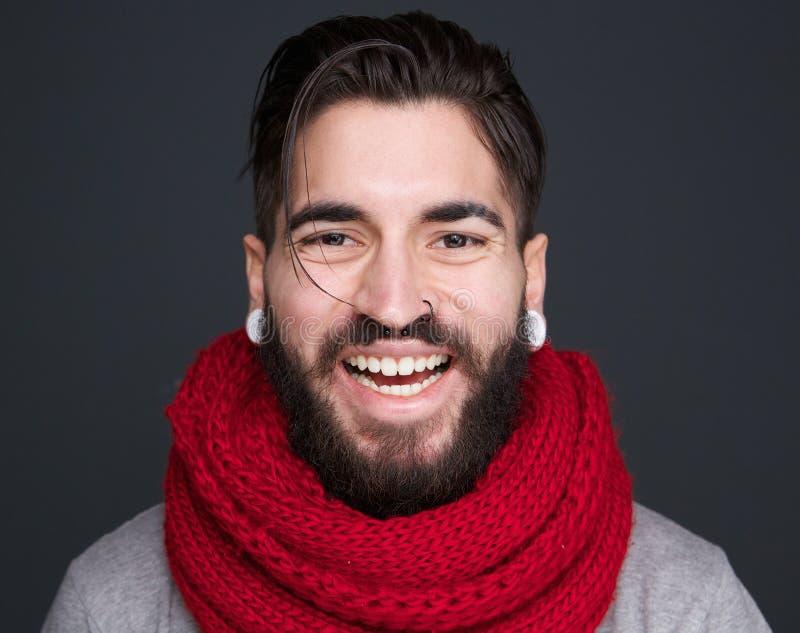Homem de riso com barba e lenço imagens de stock