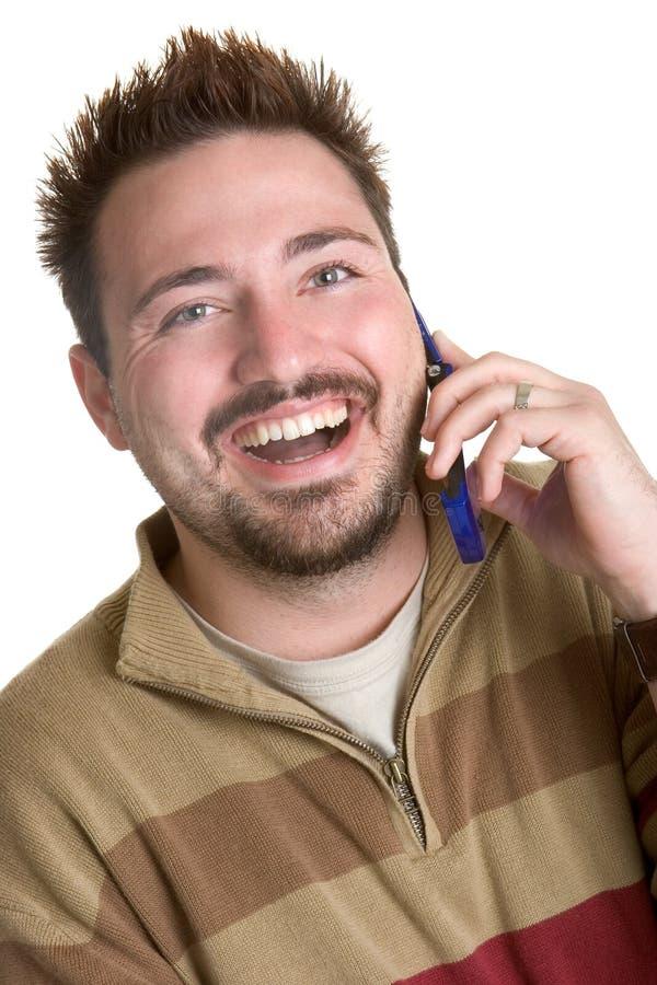Homem de riso do telefone fotografia de stock