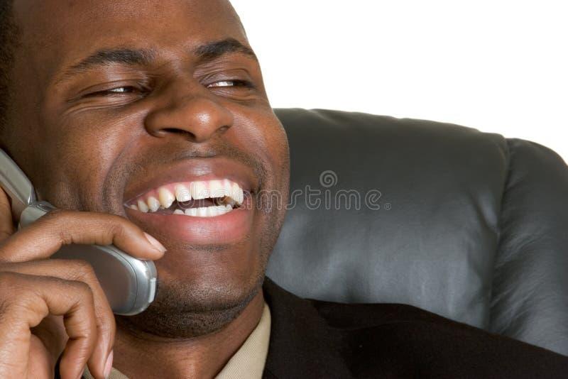 Homem de riso do telefone imagens de stock
