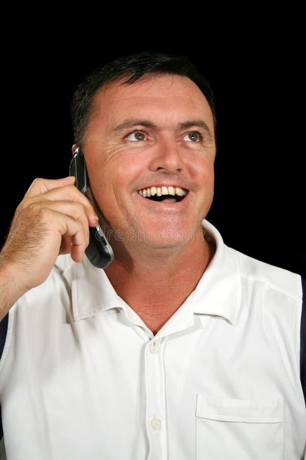 Homem de riso do telefone de pilha imagens de stock royalty free