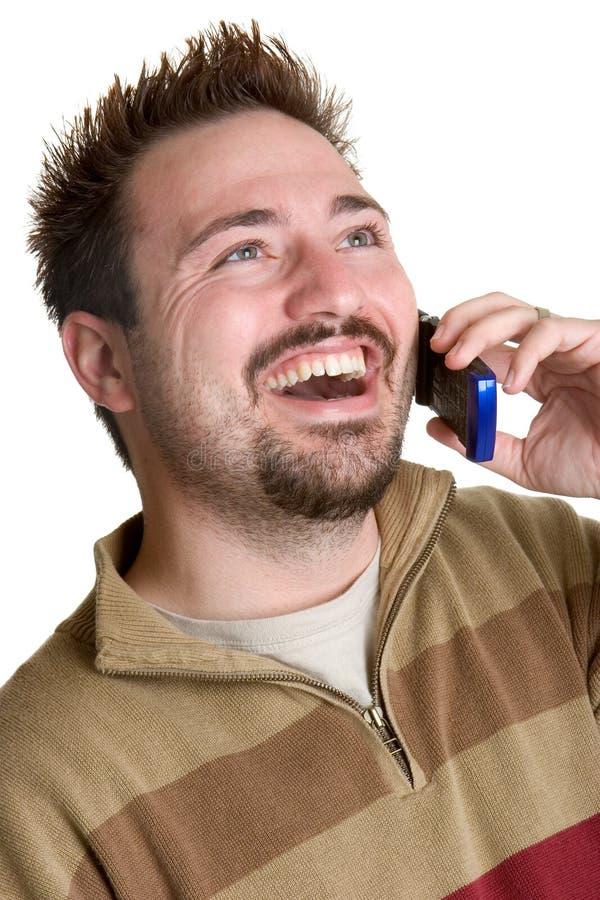 Homem de riso do telefone de pilha fotografia de stock