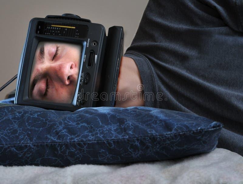 Homem de sono da tevê fotografia de stock
