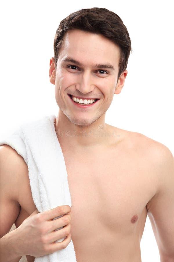 Homem De Sorriso Com Toalha Imagens de Stock Royalty Free