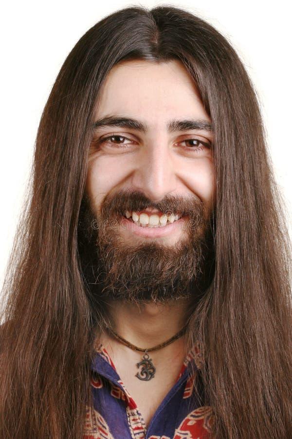 Homem de sorriso de cabelos compridos do hippie fotografia de stock