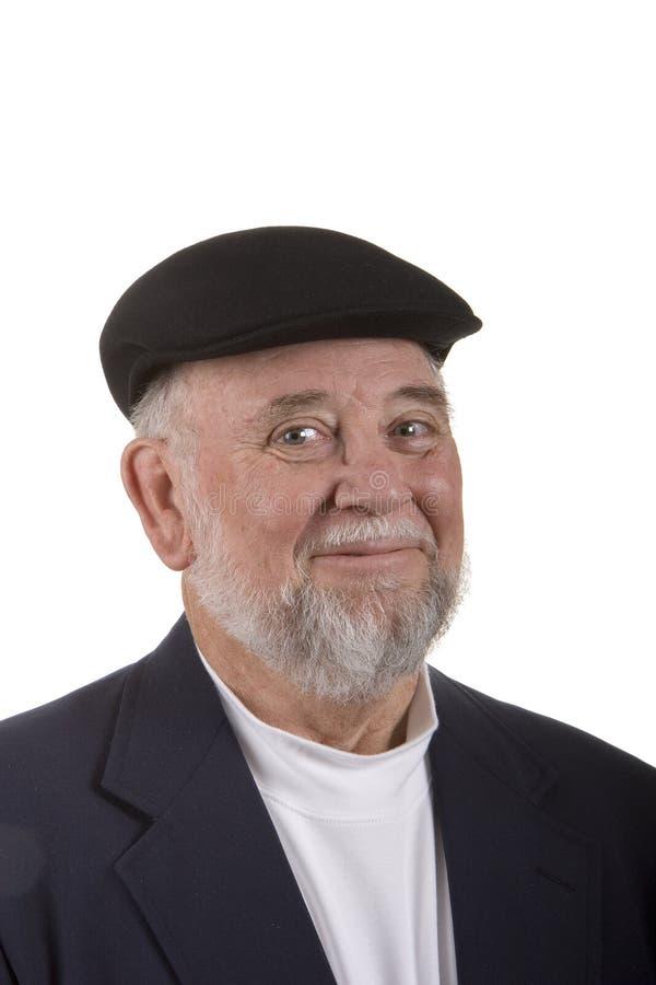 Homem de sorriso mais idoso com chapéu imagem de stock royalty free