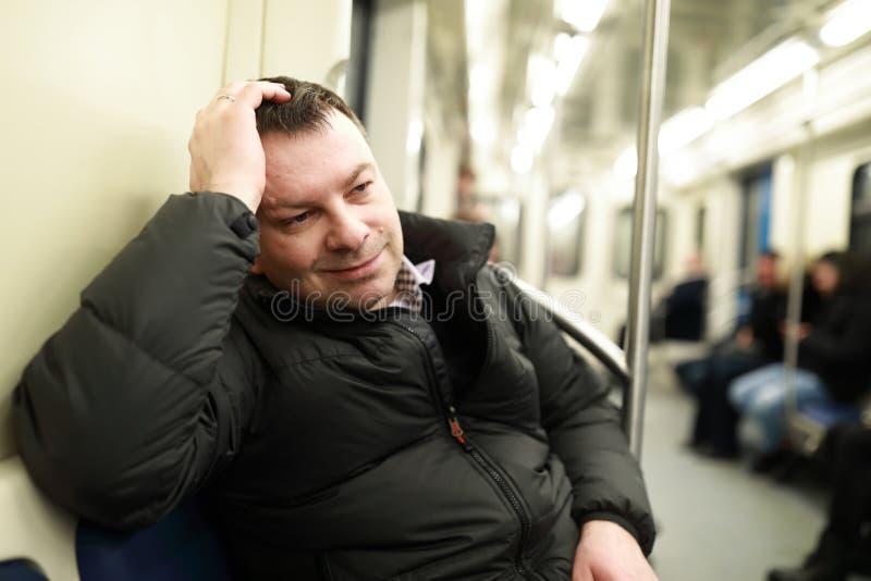 Homem de sorriso no metro imagem de stock royalty free
