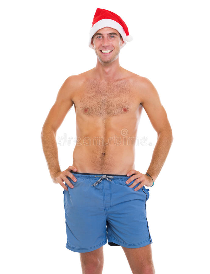 Homem de sorriso no short da praia e no chapéu de Santa imagem de stock