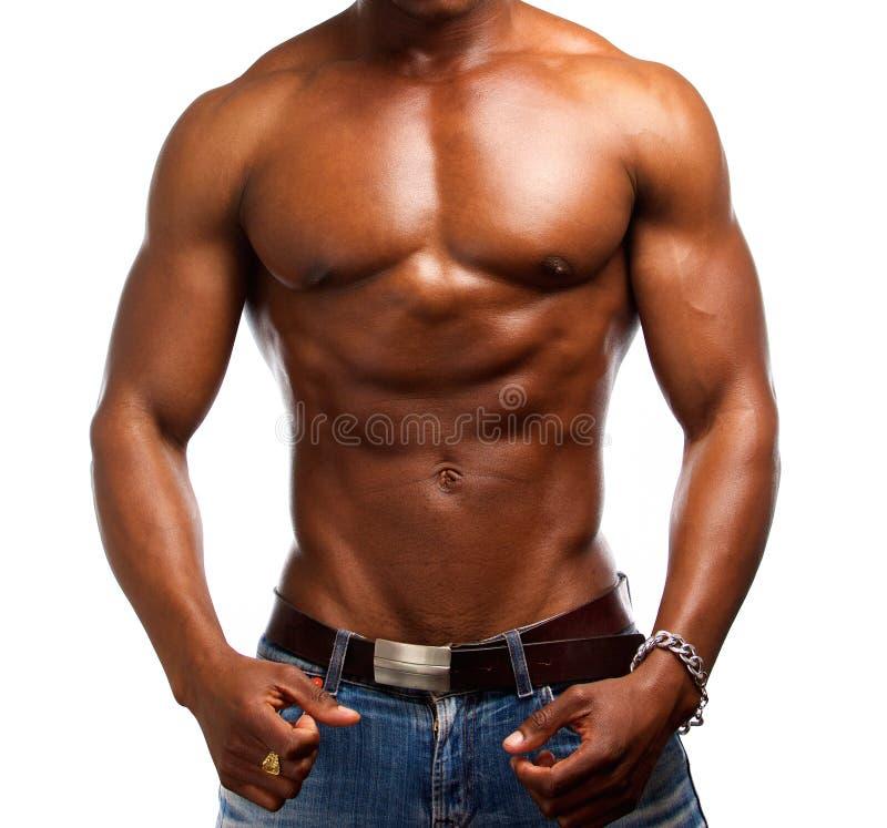 Homem descamisado afro-americano muscular imagens de stock