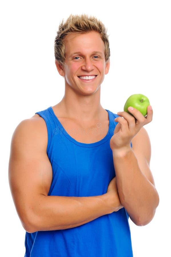Homem desportivo com maçã foto de stock royalty free
