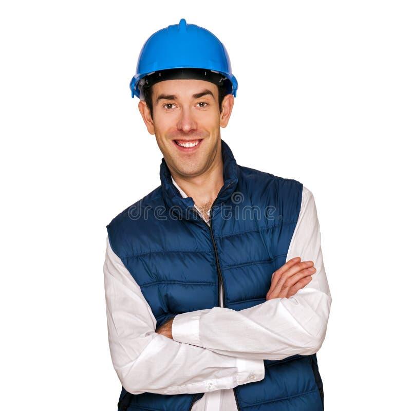Homem do arquiteto, capacete azul, isolado sobre o fundo branco foto de stock
