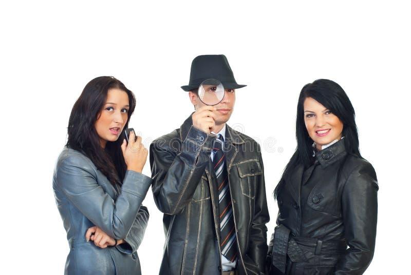 Homem do detetive e assistentes das mulheres fotos de stock royalty free