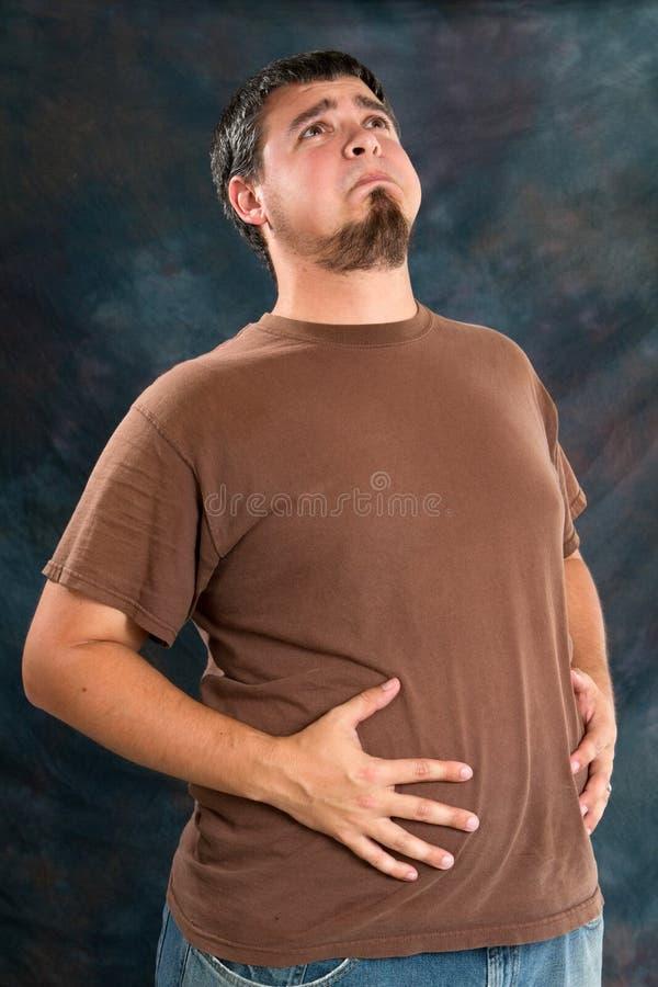 Homem do excesso de peso com Indegestion fotografia de stock royalty free