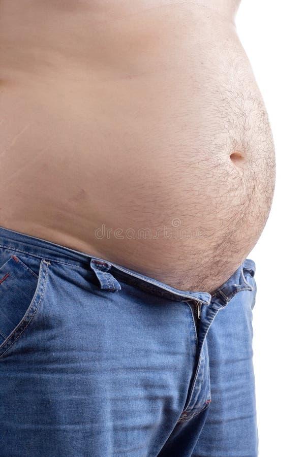 Homem do excesso de peso com sua metade das calças aberta imagem de stock