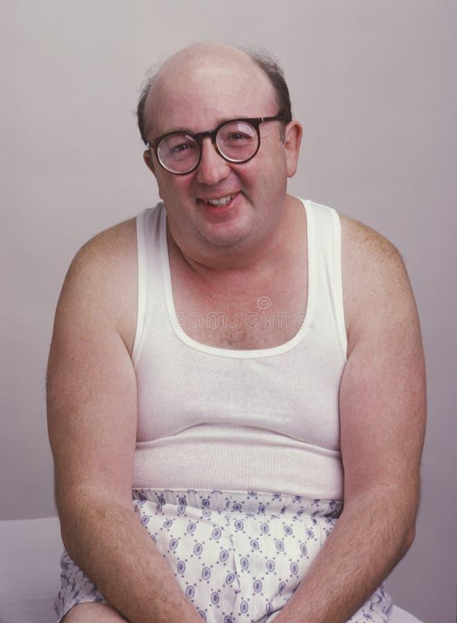 Homem do excesso de peso na parte superior de tanque imagens de stock royalty free
