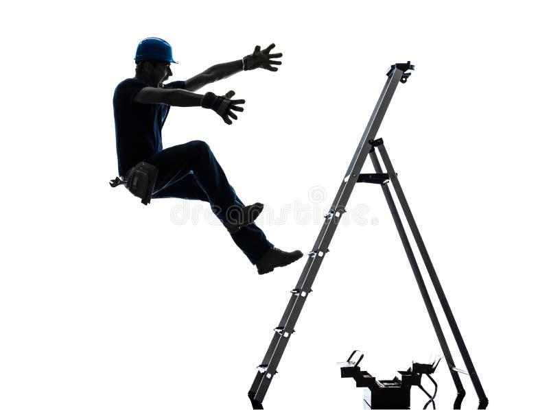 Homem do trabalhador manual que cai da silhueta da escada fotografia de stock