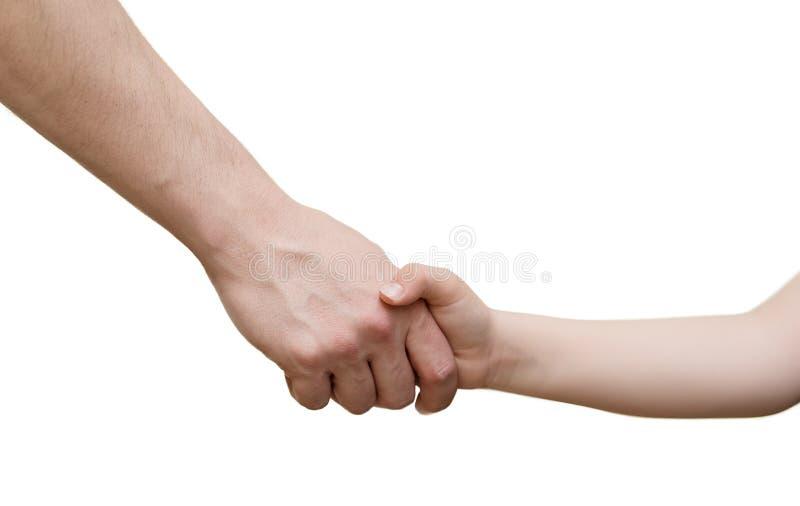Homem e aperto de mão novo do menino foto de stock