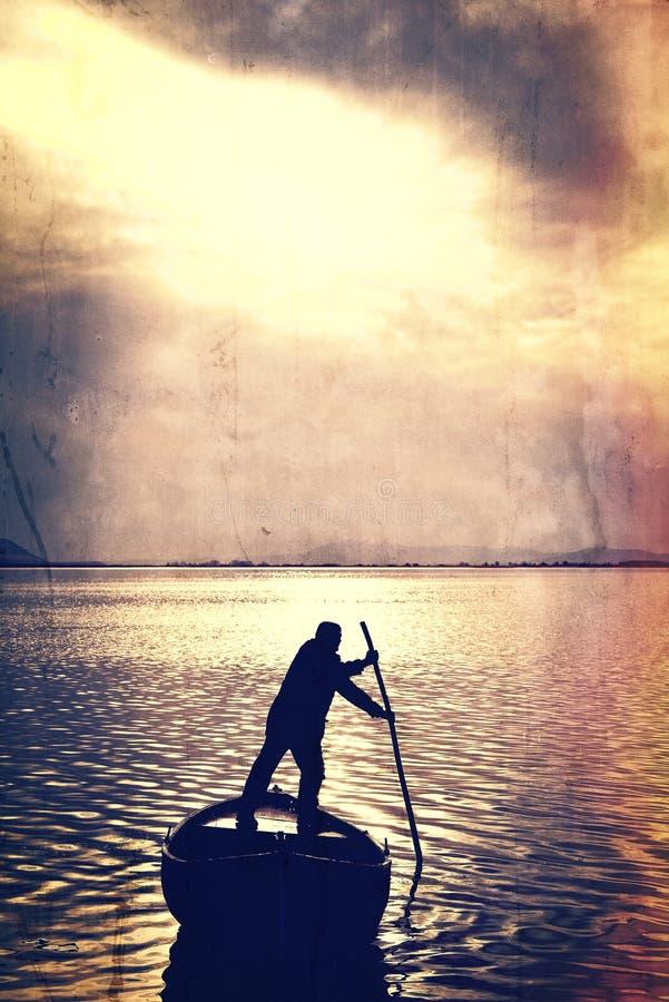 Homem e barco imagem de stock