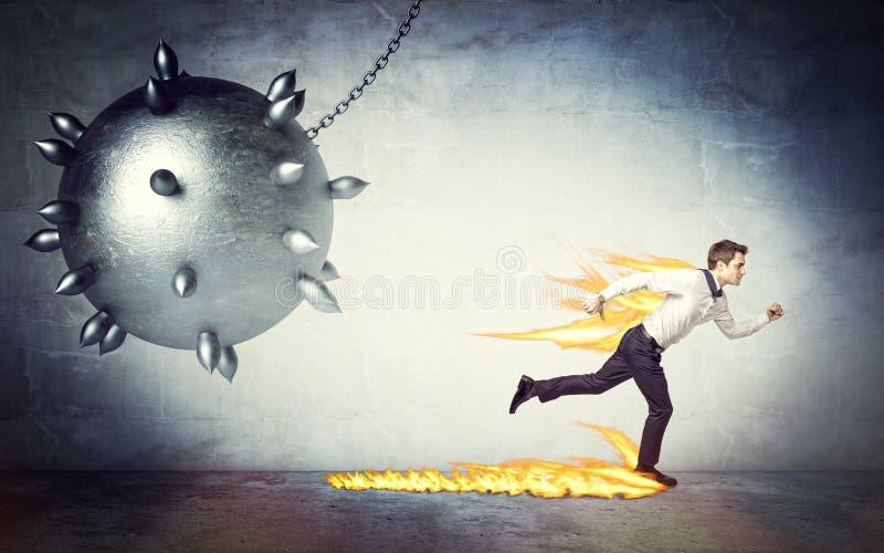 Homem e bola de demolição fotografia de stock royalty free