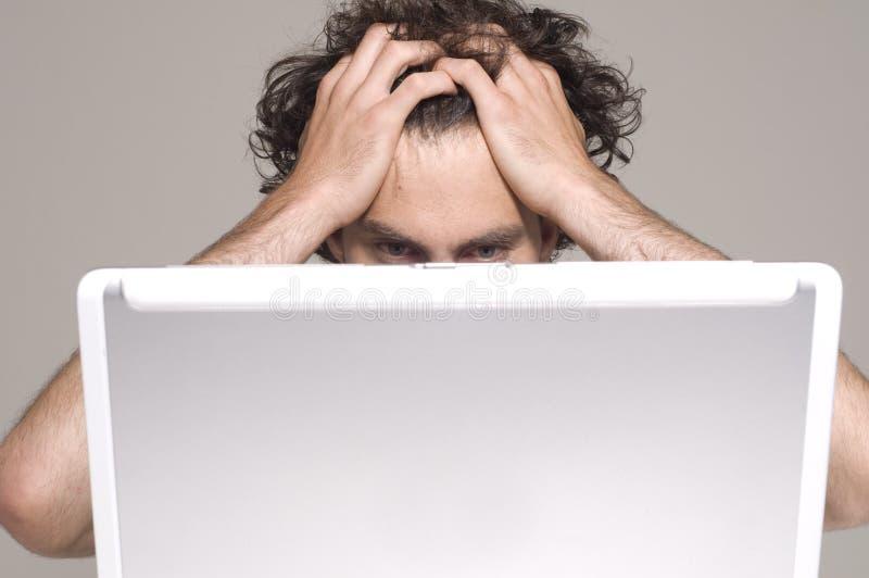 Homem e computador imagem de stock royalty free