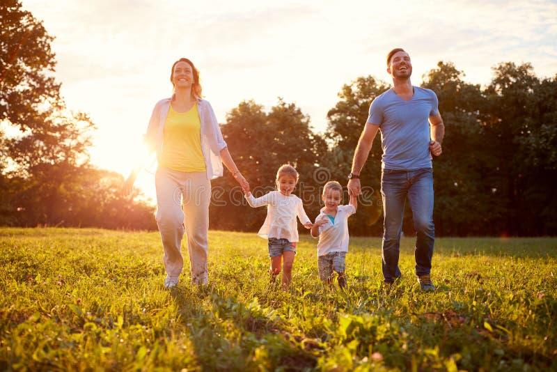 Homem e fêmea com as crianças exteriores fotografia de stock royalty free
