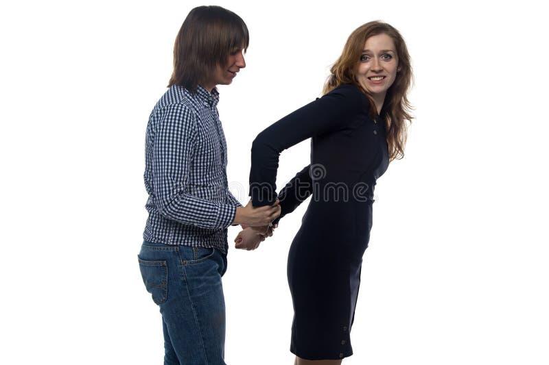 Homem e jovem mulher com pares de algemas fotos de stock royalty free