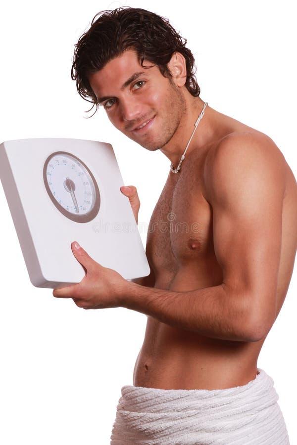 Homem e máquina felizes consideráveis da ponderação fotos de stock