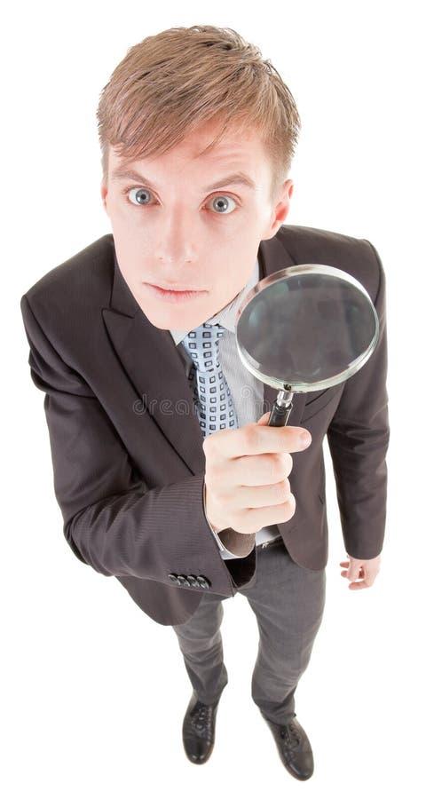 Homem e magnifier fotos de stock royalty free