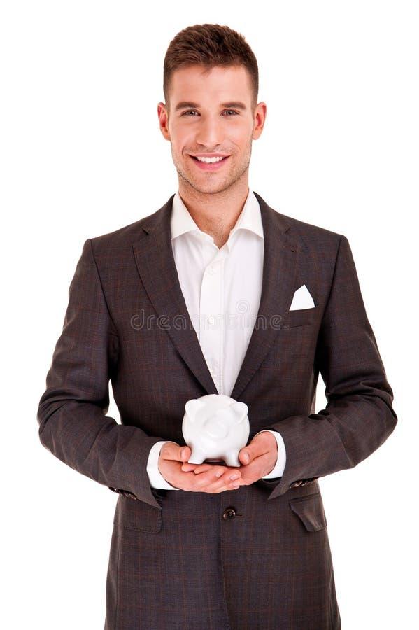 Homem e mealheiro de negócio imagem de stock royalty free